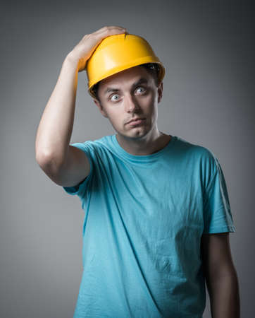 worker in helmet holding his head photo