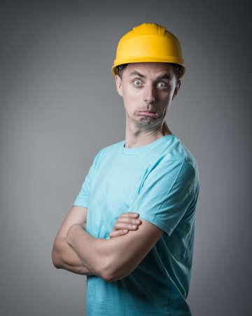 worker in helmet surprised photo