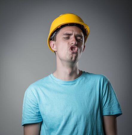 resent: worker in helmet resent