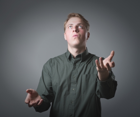 funny man standing and juggling with copy space Stock Photo