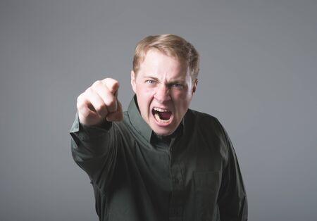 Angry man shouting photo