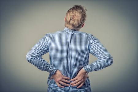 businessman with strong back pain photo