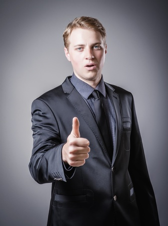 Happy smiling cheerful business man with thumbs up Stock Photo - 19767605