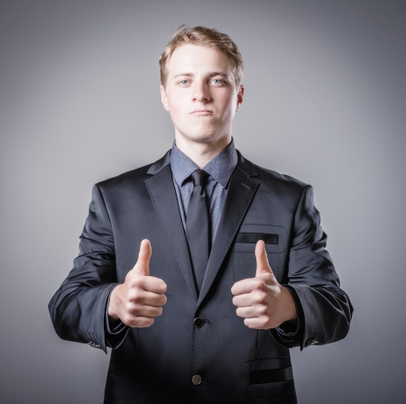 young man showing two thumbs up photo