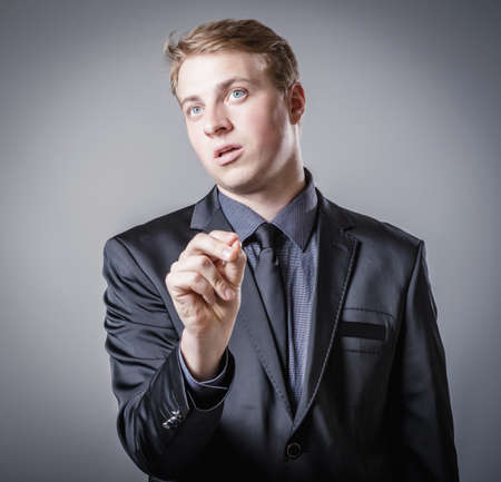 young man holding something with your fingers photo
