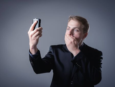 young businessman talking on a smartphone photo