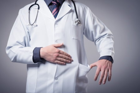 young doctor holding a pocket for bribe