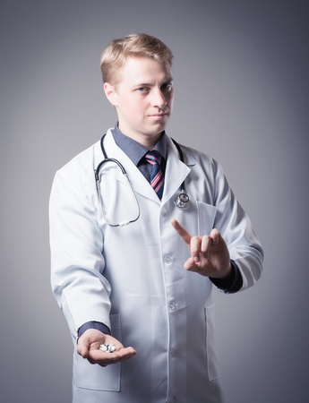 young doctor holding a pill Stock Photo - 19767502
