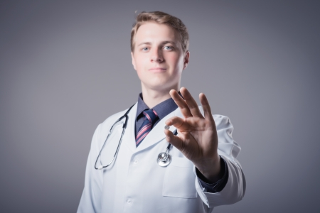 young doctor holding a pill Stock Photo - 19767392