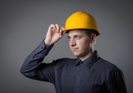 engineer adjusts his helmet photo