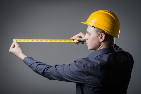 worker often with a measuring tape Stock Photo