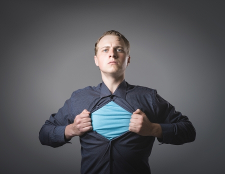 Businessman showing a superhero suit underneath his suit photo