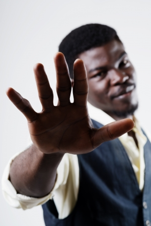 Man holding up his hand in a protest gesture