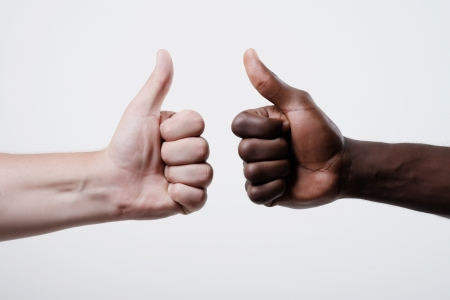 African American man and caucasian man show Thumbs up