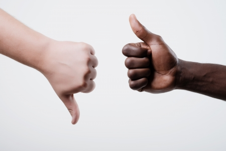 African American man Thumbs up, caucasian man show a thumbs down photo
