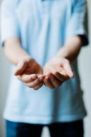 Man holding something in his hands Standard-Bild