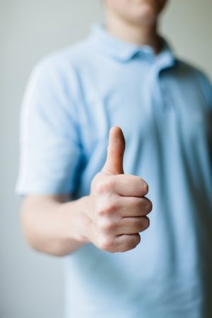 Man gesturing thumbs up photo