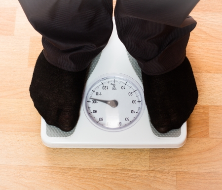 Overweight man on scales photo