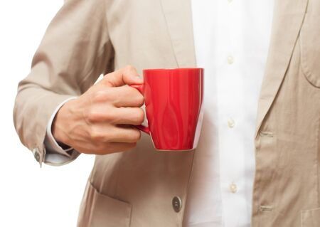Business man with a cup of tea, of coffee photo