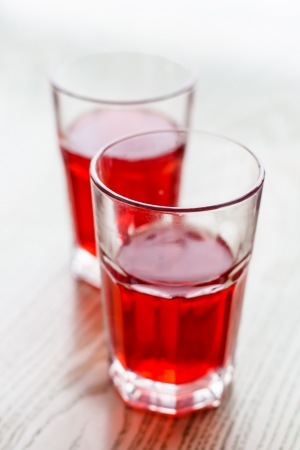 cranberry fruit: Two red cranberry fruit drinks in glass