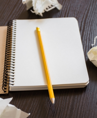 Notebook with a pencil and crumpled sheets of paper. Concept of searching for ideas Stock Photo - 19767355