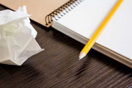 Notebook with a pencil and crumpled sheets of paper. Concept of searching for ideas Stock Photo - 19767373