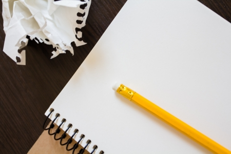 Notebook with a pencil and crumpled sheets of paper. Concept of searching for ideas Stock Photo - 19767293