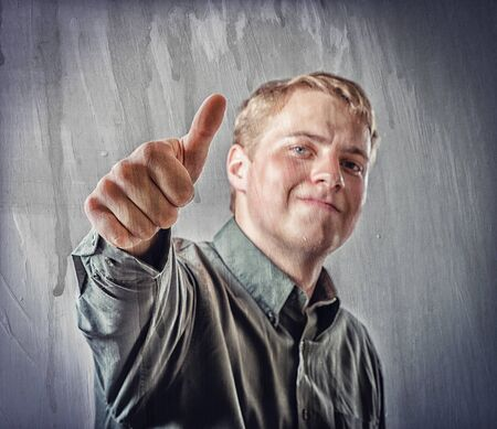 Smiling businessman with thumb up photo
