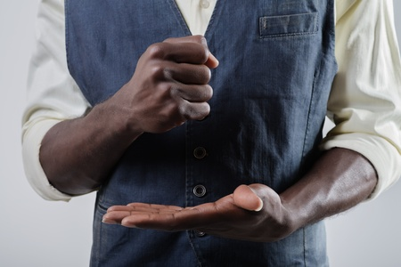 African-American bet a fist into his palm photo