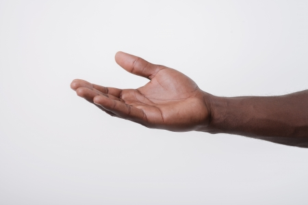 reaching hands: African-American holds open palm