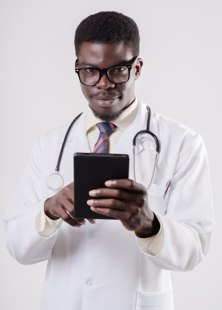African-American doctor with a digital tablet photo