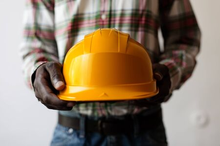 African American holding a construction helmet photo
