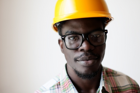 African American in a construction helmet photo