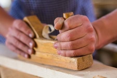 planer: Hands working planer Stock Photo