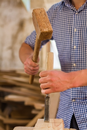 hand working in wood chisel carpenter tool hammer photo