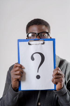 African-American man holding a question mark photo
