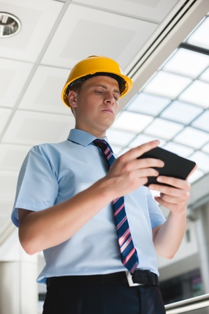 engineer in a helmet with a digital tablet photo