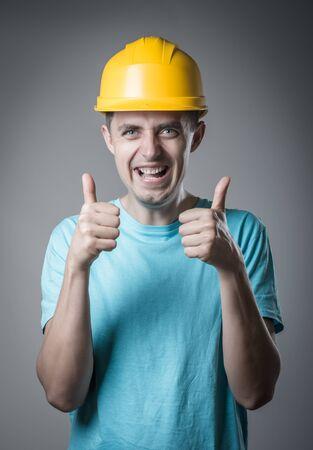 worker in helmet thumbs up photo