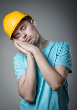 worker in helmet sleeps photo