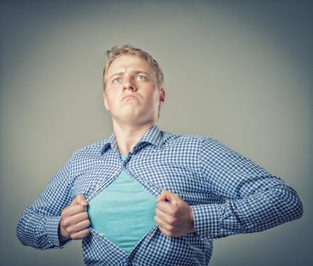 Businessman showing a superhero suit underneath his suit Standard-Bild