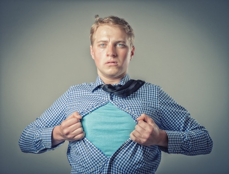 Businessman showing a superhero suit underneath his suit photo