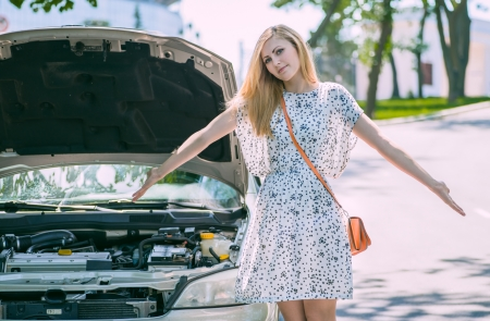 young beautiful woman car broke down photo