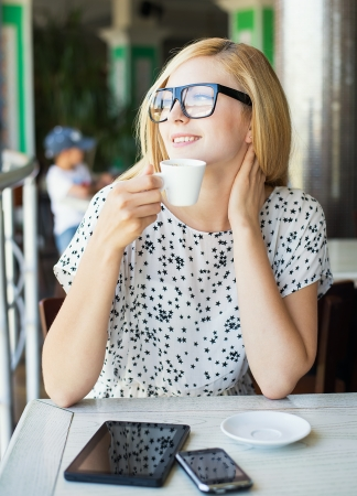 businesswoman with Tablet PC  in a cafe drinking coffee photo