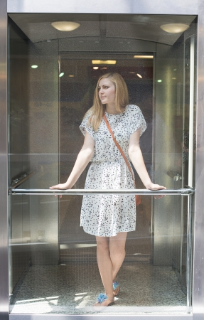 young beautiful woman in an elevator photo