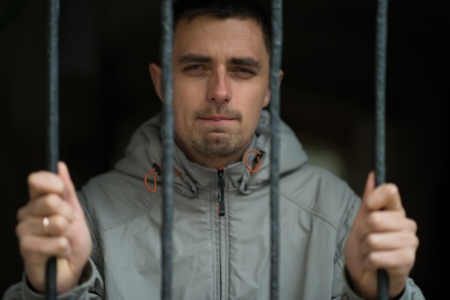 man behind bars Stock Photo - 23467651
