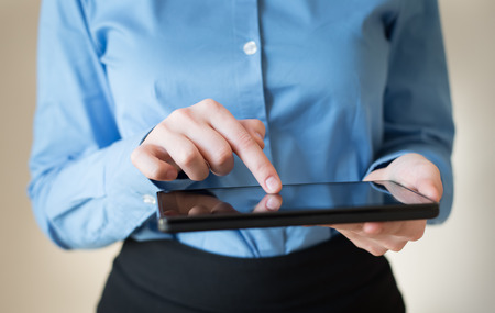 woman uses a digital tablet. Modern gadget in hand. photo