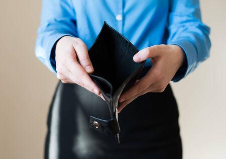 empty wallet: woman holding an empty wallet