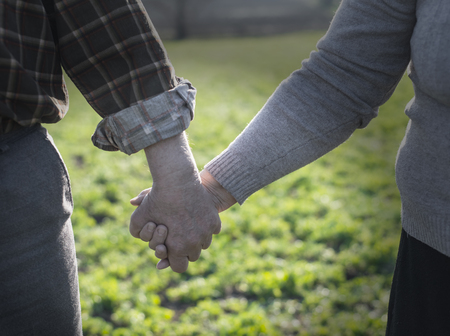 two people with others: Hand in hand