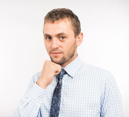 Man holding hand on chin photo