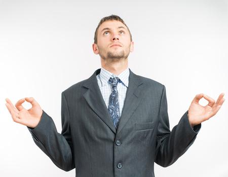 levitating: young businessman levitating in yoga position, meditation Stock Photo